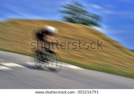 Blurred bike race cyclists at high speed - stock photo