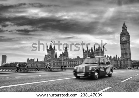 Blurred black taxi cab moving on Westminster Bridge - London. - stock photo