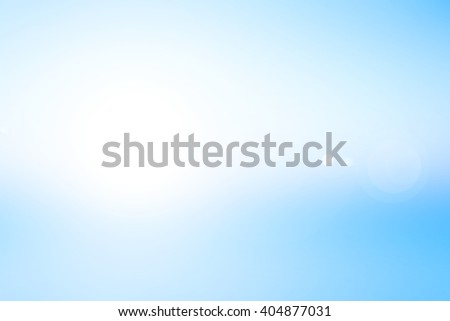 blurred blue flash gradient background with white rays flare lights.blur backdrop concept.pastel cool tone color.colorful vivid image:brightening sunshine day season:holiday vacation conception. - stock photo