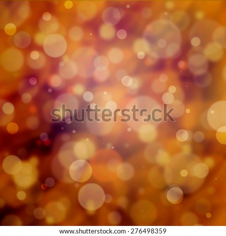 blurred bokeh background burgundy orange and gold magical bubbles or circles floating in the sunshine with blurry abstract out of focus background - stock photo