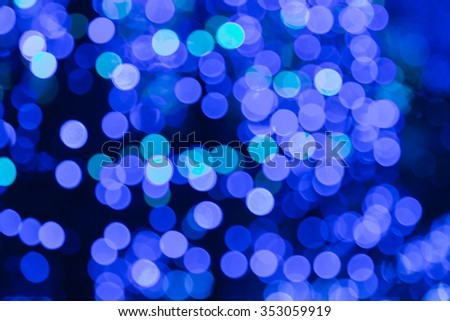 Blurred bokeh blue christmas lights background - stock photo