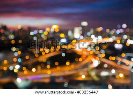 Blurred bokeh city downtown lights night view - stock photo