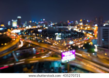 Blurred bokeh light night view city road overpass, abstract backgroundB - stock photo