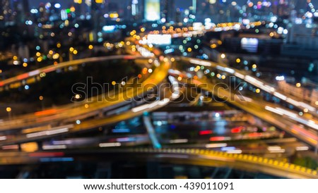Blurred bokeh lights city highway interchanged night view, abstract background - stock photo