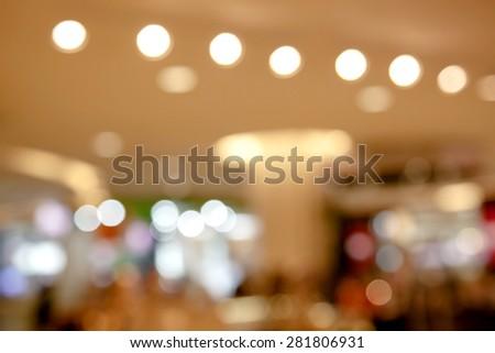Blurred bokeh lights in shopping center - stock photo