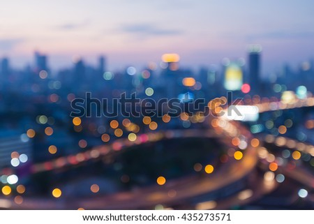Blurred bokeh lights, interchanged road with CBD background - stock photo