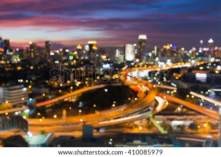 Blurred bokeh lights night view, city downtown and road intersection  - stock photo