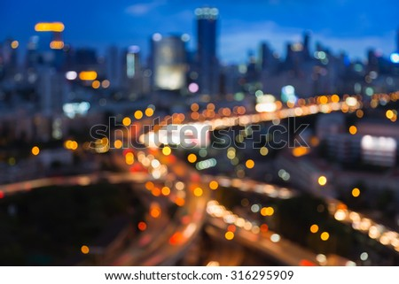 Blurred bokeh lights of city freeway intersection with cit - stock photo