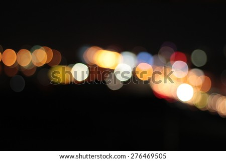 Blurred bokeh of car in city at night