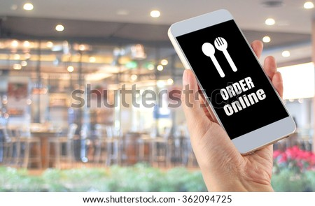 blurred bokeh restaurant hand smartphone word order online - stock photo