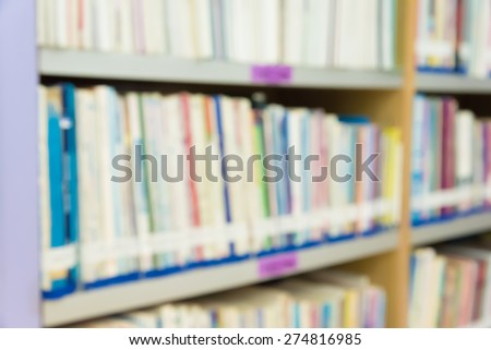Blurred books in public library. Blurred effect. Background for you pictures