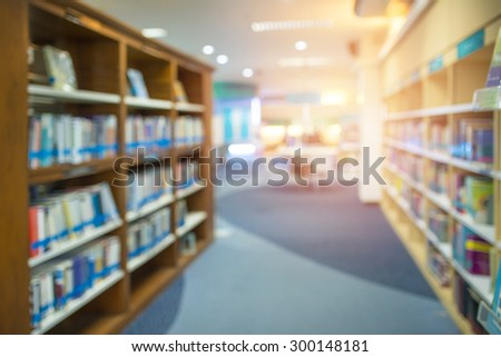 Blurred books in public library. Image Blurred effect. Background. - stock photo