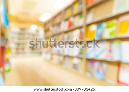 Blurred books on the shelf in public library. Blurred effect. Ba - stock photo