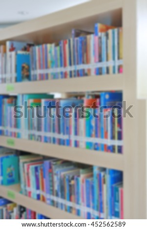 Blurred bookshelf in library, abstract blur defocused background