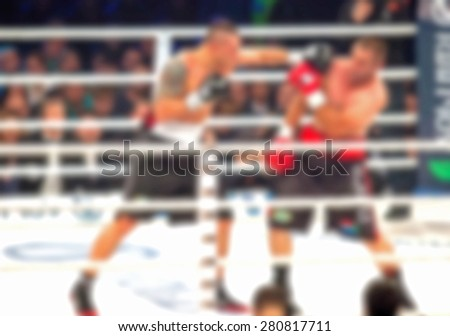 Blurred boxing fight. Abstract sports background with bokeh - stock photo