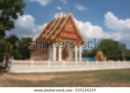 Blurred Buddhist temple in thailand - stock photo
