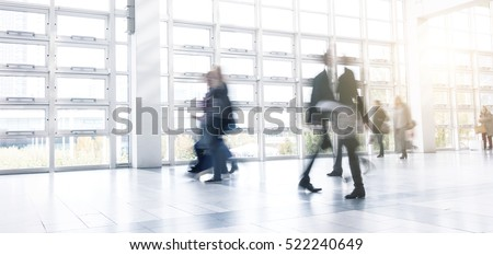 Blurred business people using a walkway at a Exhibition
