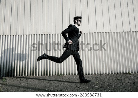 Blurred Businessman running fast to the office. - stock photo