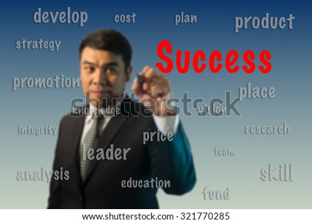 Blurred businessman writing success concept.