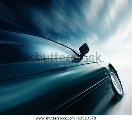 Blurred car and blue sky with clouds