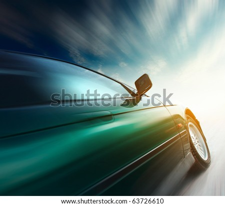 Blurred car on road and sky with clouds - stock photo