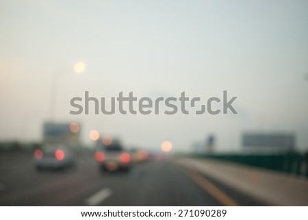 Blurred Car on the road .Blurred backgroubd - stock photo