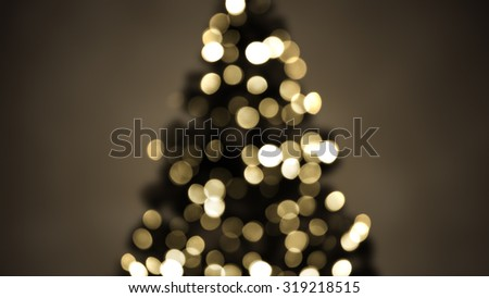 blurred christmas tree lights sepia. abstract festive background  - stock photo