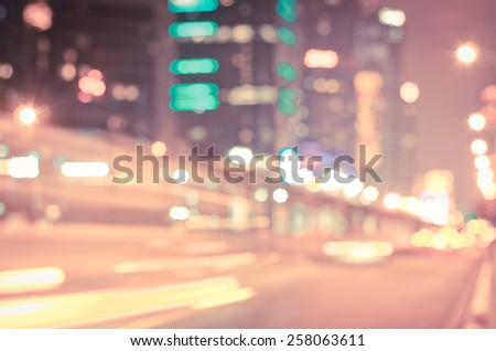 blurred city at blue hour. concept about traveling and city lifestyle - stock photo