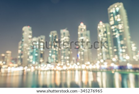 Blurred city background. building and city lights in the night - stock photo