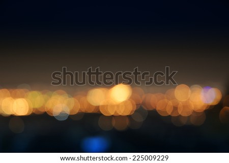Blurred city lights at night - stock photo