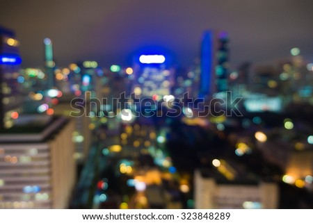 Blurred city lights bokeh illuminate at night - stock photo