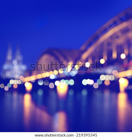 Blurred city lights with bokeh in Cologne. Germany. - stock photo