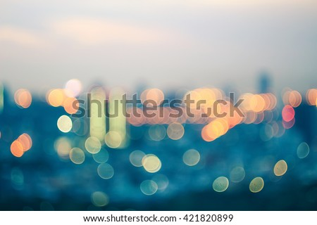 Blurred city night background. Tower Magic Art Dark Town Lifestyle Office View Street Busy Scene Road Party Glow Way Traffic Effect Dot Motion Round Bright Travel Vibrant Building Invest Skyline - stock photo