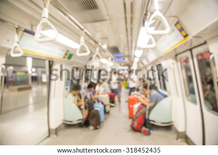 Blurred city people lifestyle background, inside the train - stock photo