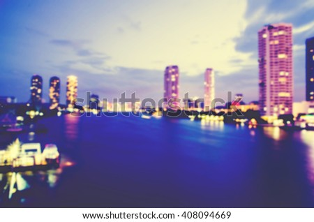blurred cityscape with business buliding and liveing zone - stock photo