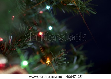 Blurred close up of Christmas tree with lights. - stock photo
