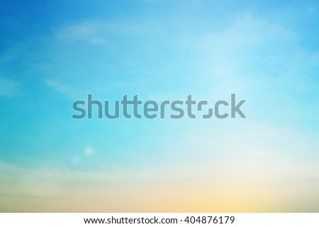 blurred colorful natural sky clouds landscape background with light.blurry sunshine wallpaper concept.backdrop pastel cool tone.blur idyllic shores sundown hour.abstract dream magic coastline dramatic - stock photo