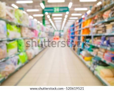 Blurred colorful supermarket products on shelves - background with shallow DOF