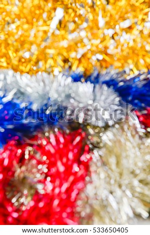 blurred colorful tinsel Christmas background, soft focus