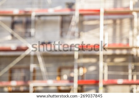 Blurred construction site of apartment block - stock photo