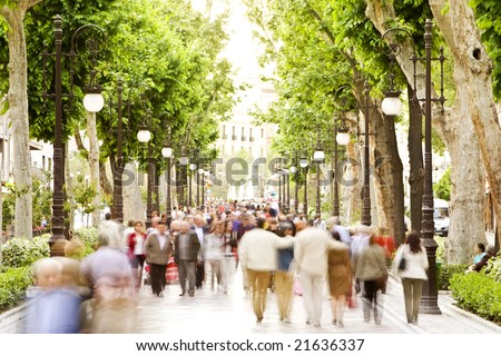 Blurred crowd in the street, high key. - stock photo