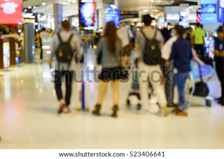 Blurred Crowd of People at Airport, General Public Concept with Unrecognizable Crowded Population out of Focus