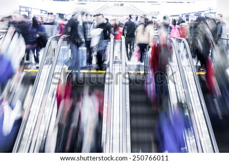 Blurred crowed people in shopping mall - stock photo