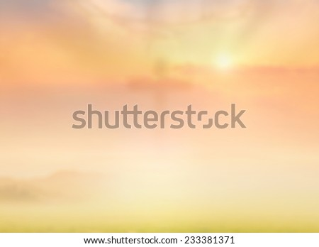 Blurred crown of thorns and the cross on sunset background. - stock photo