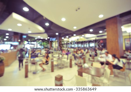 blurred customers in restaurant - blur background - stock photo