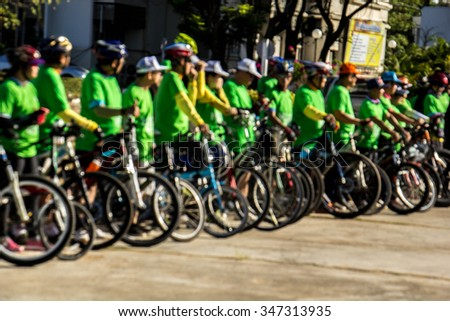 Blurred cyclists at cycle event in a  day. - stock photo