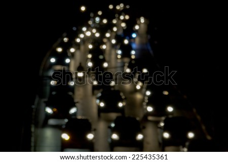 Blurred De-focused Lights of Heavy Traffic on a Wet Rainy City Road at Night - Commuting at Rush Hour Concept - stock photo
