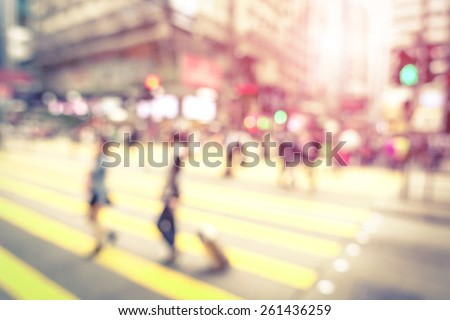Blurred defocused abstract background of people walking on zebra crossing with vintage marsala filter - Crowded Nathan Road street in Hong Kong city center during rush hour in urban business area - stock photo