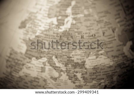 Blurred (defocused) map view of Europe on a geographical globe (vignette, vintage). - stock photo