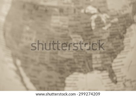 Blurred (defocused) map view of USA on a geographical globe. (vintage) - stock photo